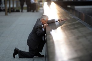 Father Grieves at 9/11 Memorial New York City